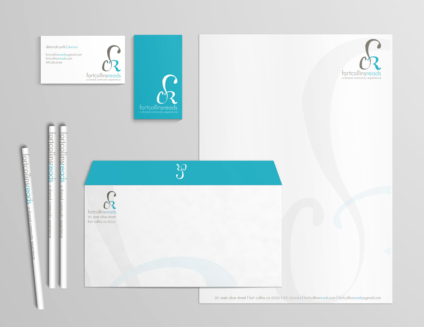Mockup of identity materials, including logo, business cards, letterhead and envelope design.
