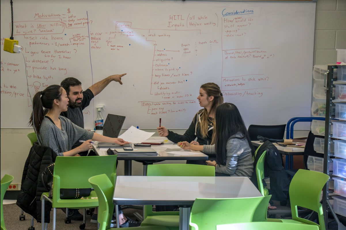 Photograph of researchers talking.